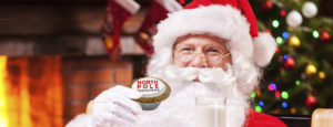 Santa Clause with a branded mince pie